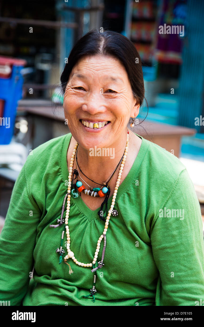 Tibetan woman in Majnu-ka-tilla, Tibetan refugee colony in Delhi, India - Stock Image