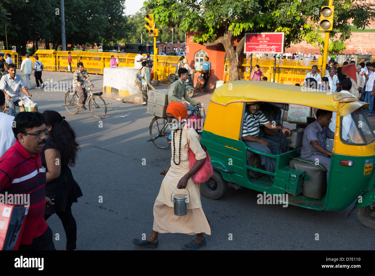 A Indian Sadhu crossing the crowded streets in New Dehli, India - Stock Image