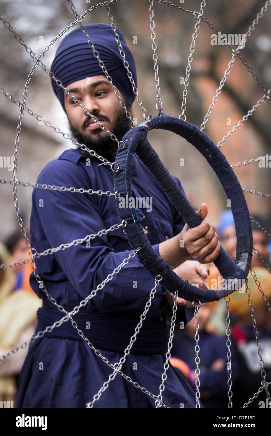Manchester, UK. 5th May, 2013. Khalsa Martial arts (Army of the pure ones).  A Nihang or Sikh warrior performs 'Gatkha', - Stock Image