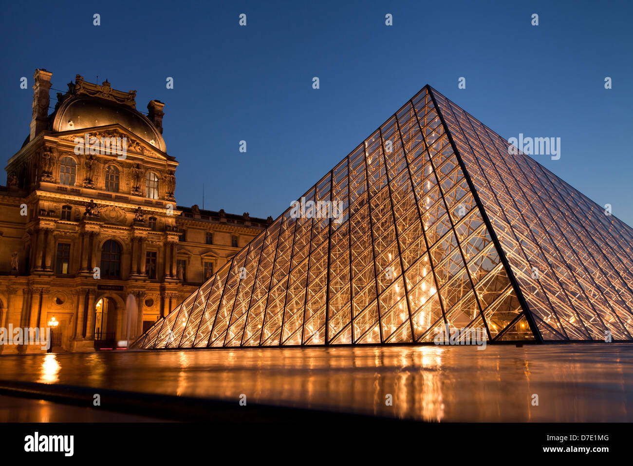 Louvre museum by night, Paris, France - Stock Image