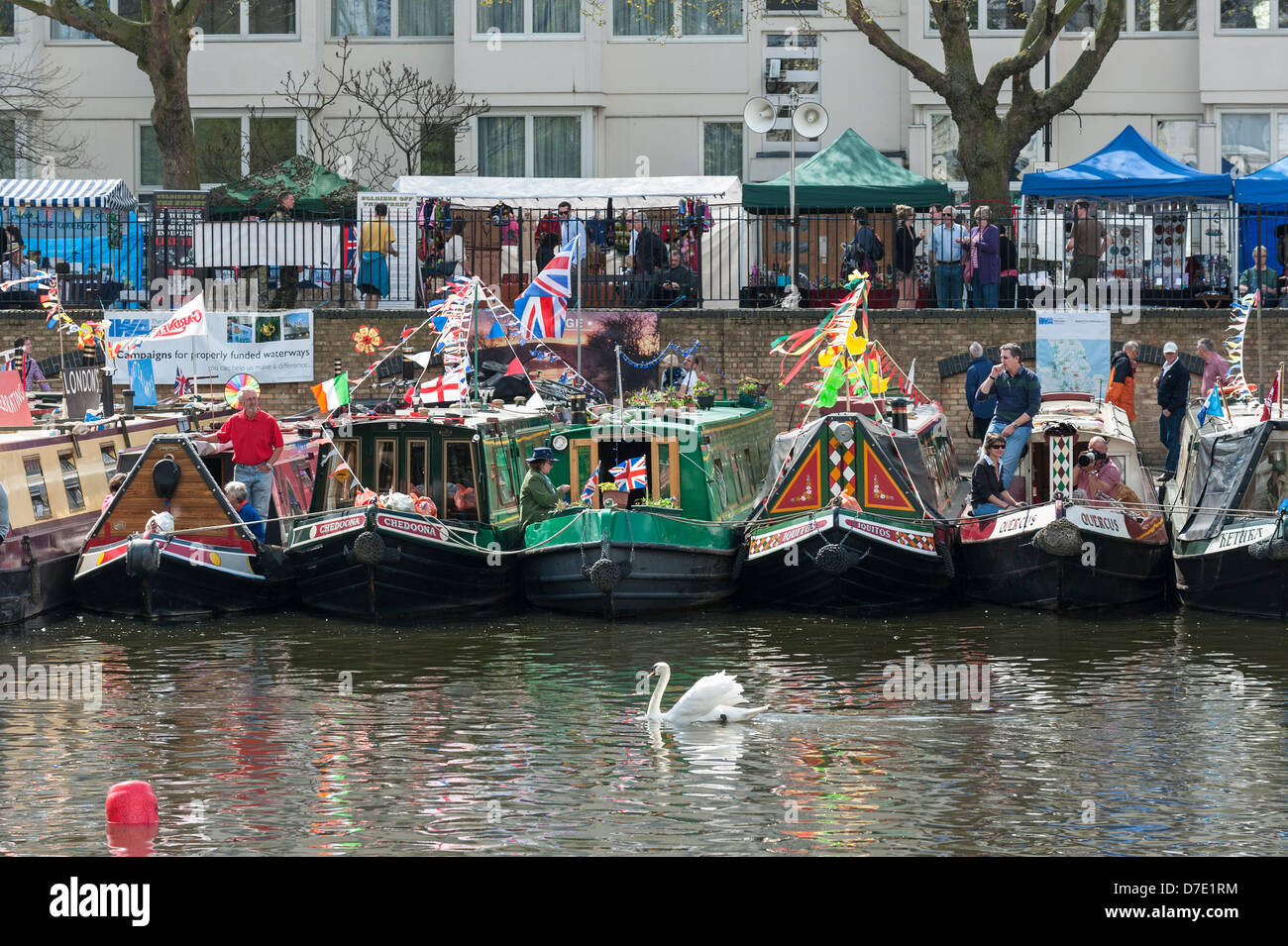 London, UK. 5th May, 2013. Canalboats decorated with colourful flags and bunting gathering for the Canalway Cavalcade - Stock Image