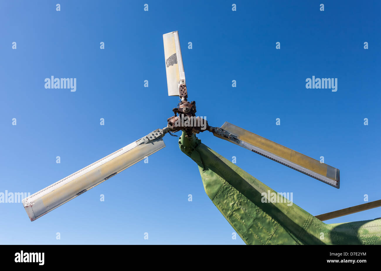 Propeller of old helicopter against blue sky - Stock Image