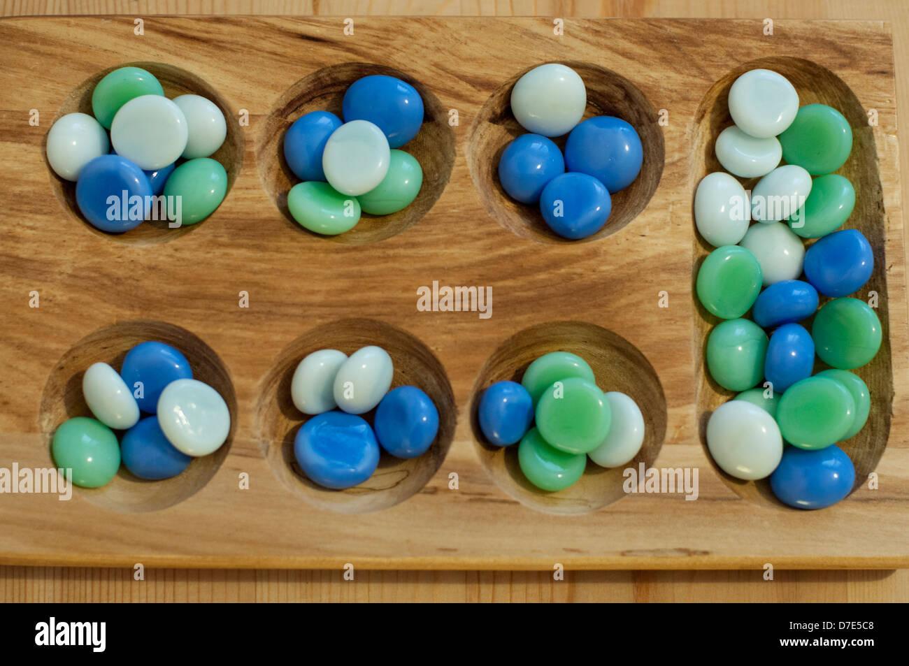 Mancala. Traditional board game. Stock Photo