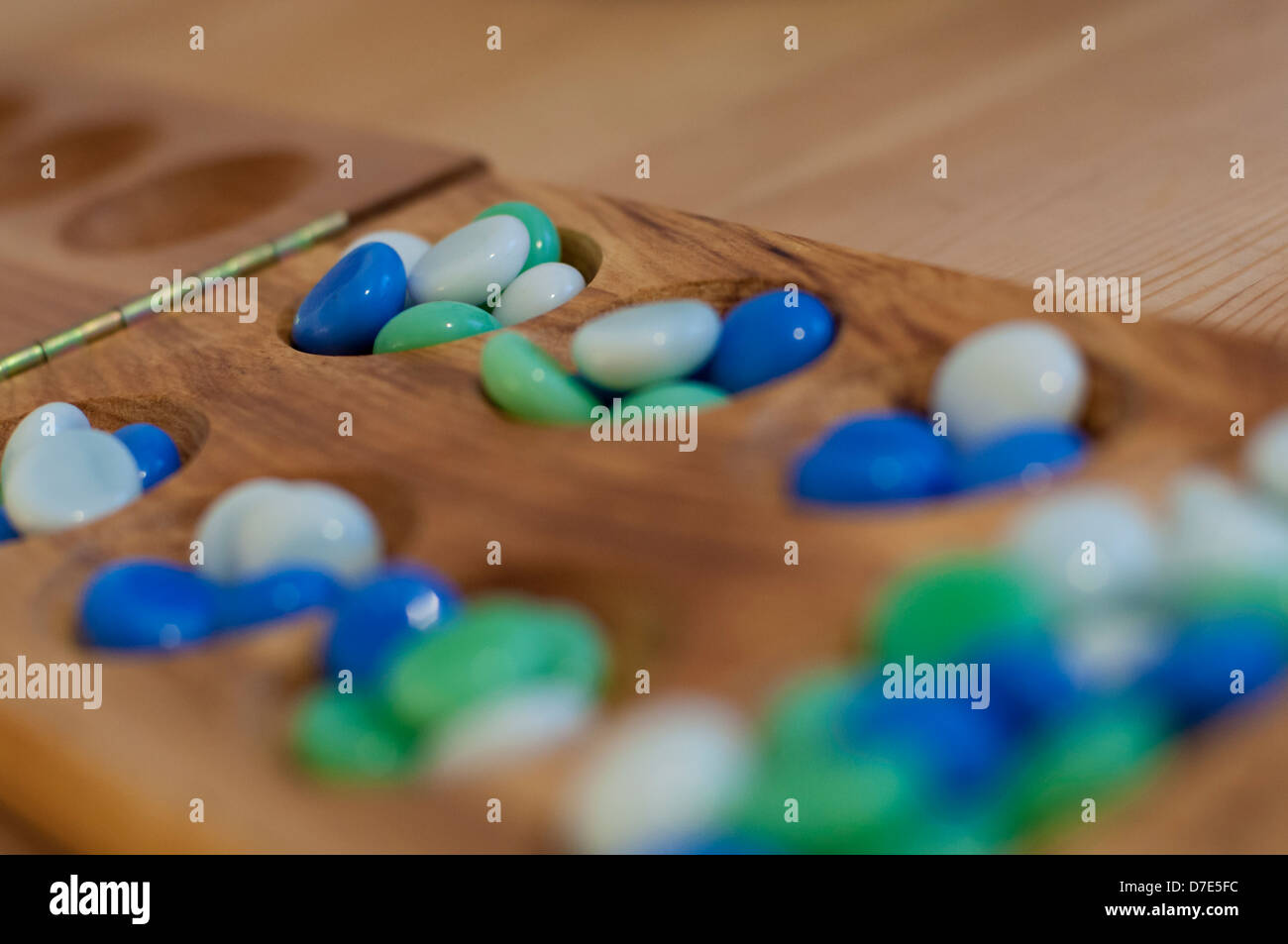 Mancala. Traditional board game. - Stock Image