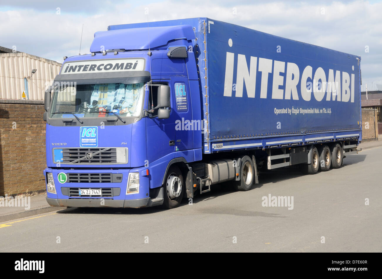 A Volvo FH 480 Euro 5 tractor unit and trailer in the livery of Turkish carrier Intercombi in Leicester, Leicestershire, - Stock Image