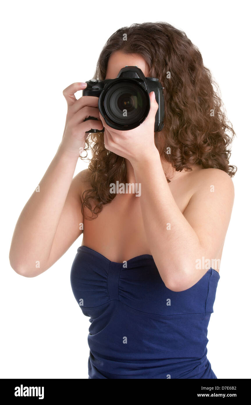 Woman holding an SLR camera, getting ready to take a picture, isolated in white - Stock Image
