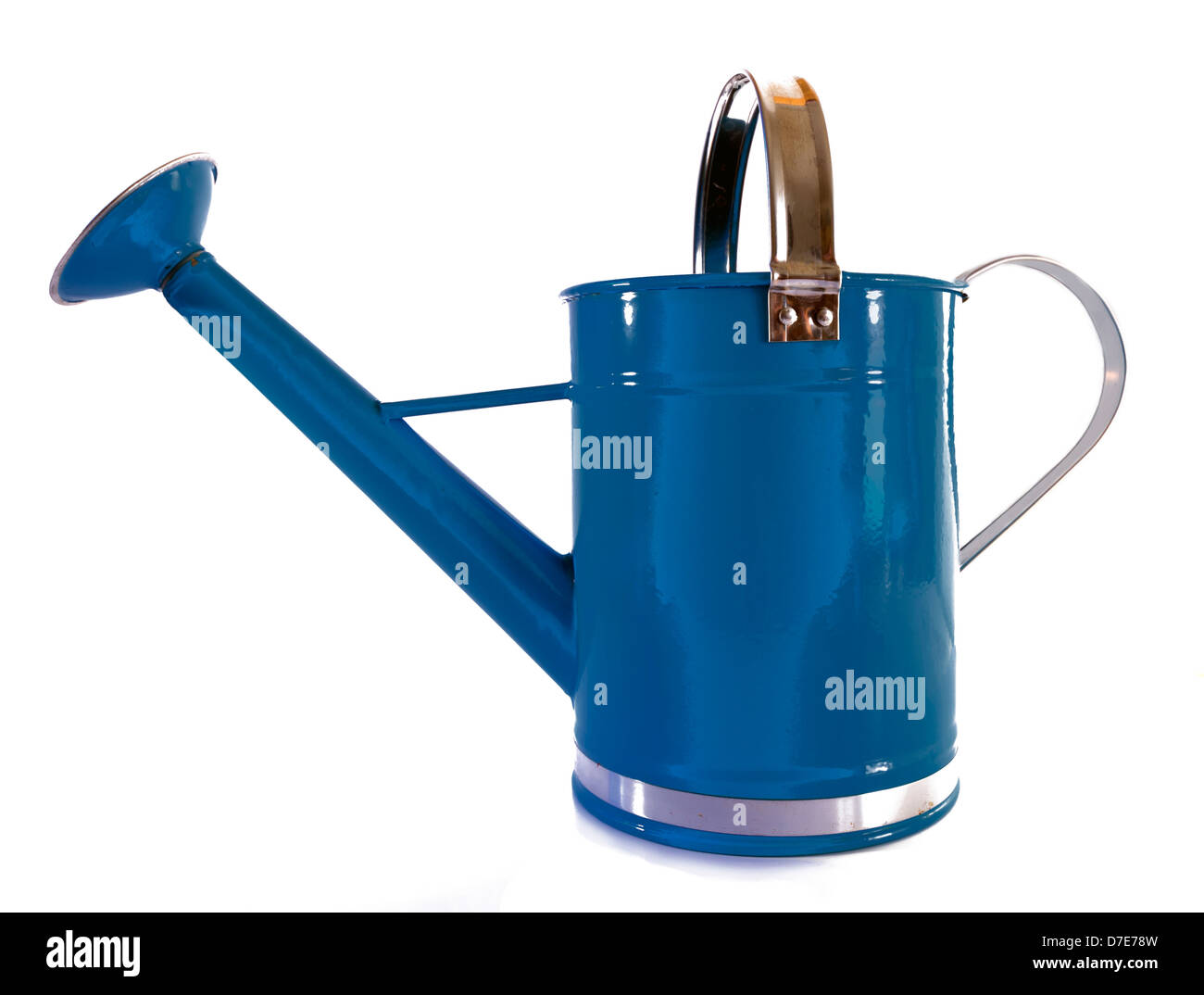 Old fashioned blue metal watering can with sprinkler enameled Stock Photo