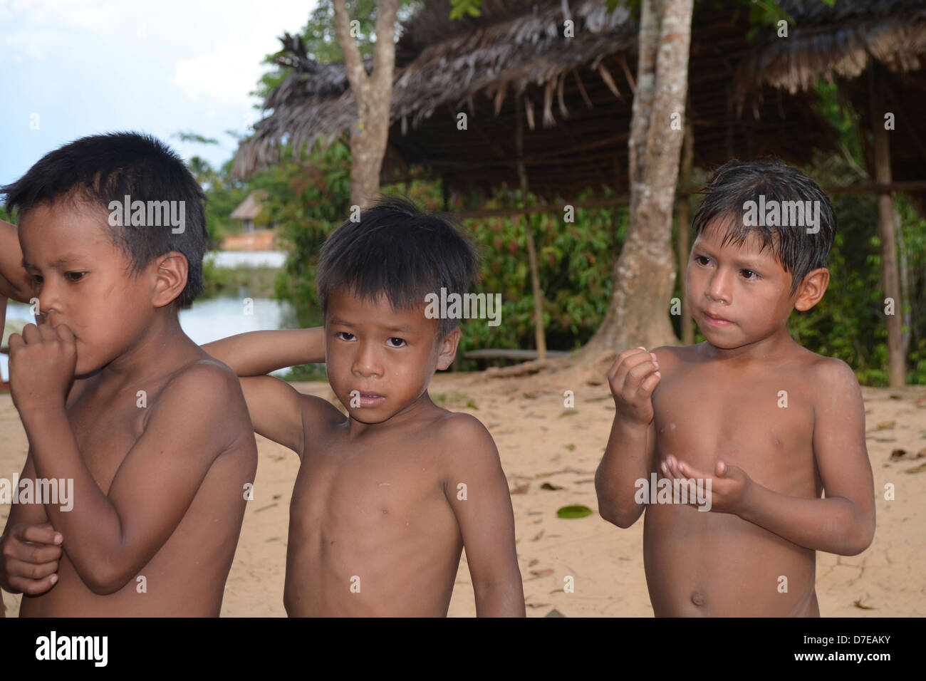 Three Native Yagua Boys Tribe In Their Village Near Iquitos The Peruvian Amazon