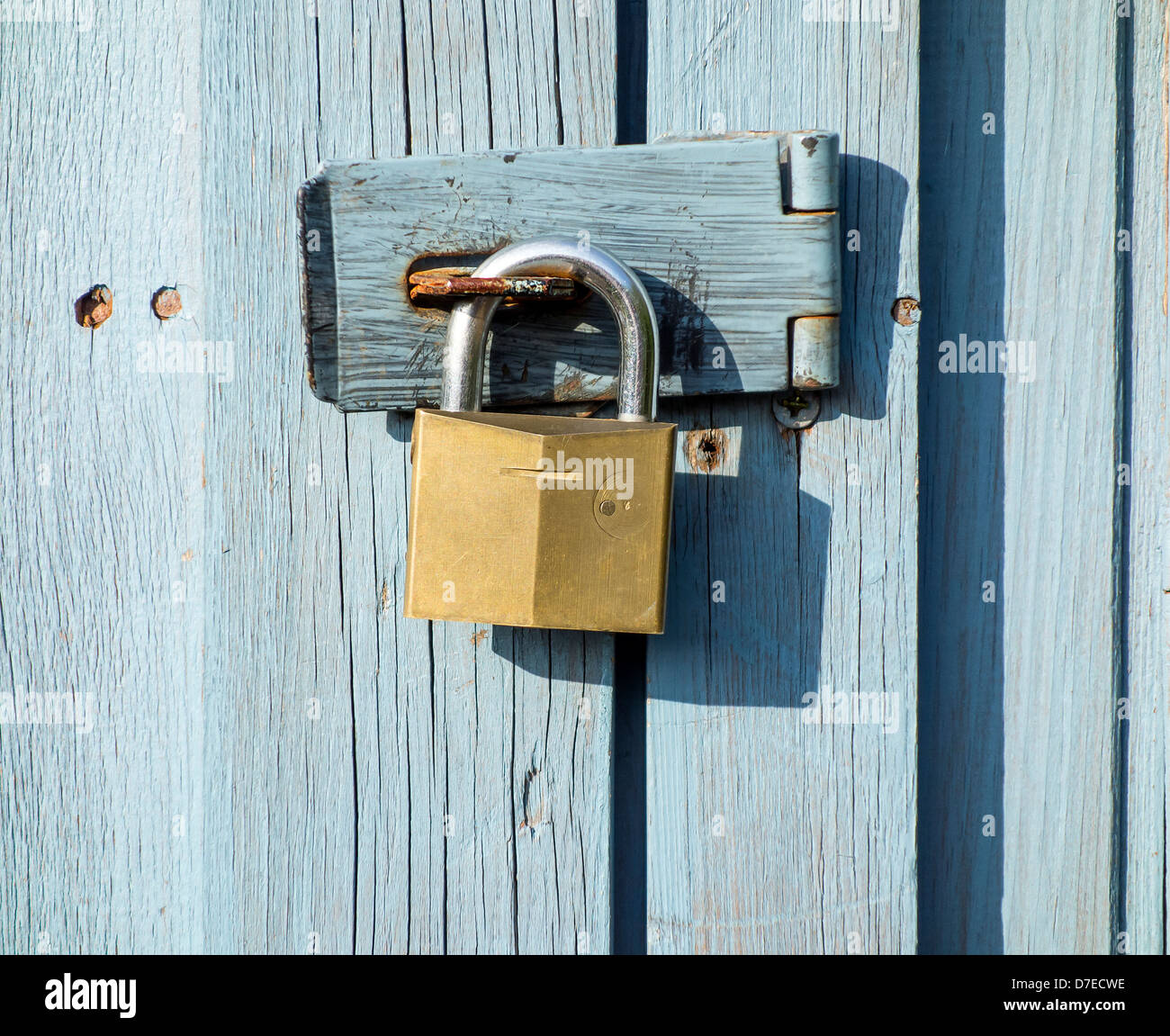 Padlock and Hasp on Allotment Shed Door Security - Stock Image