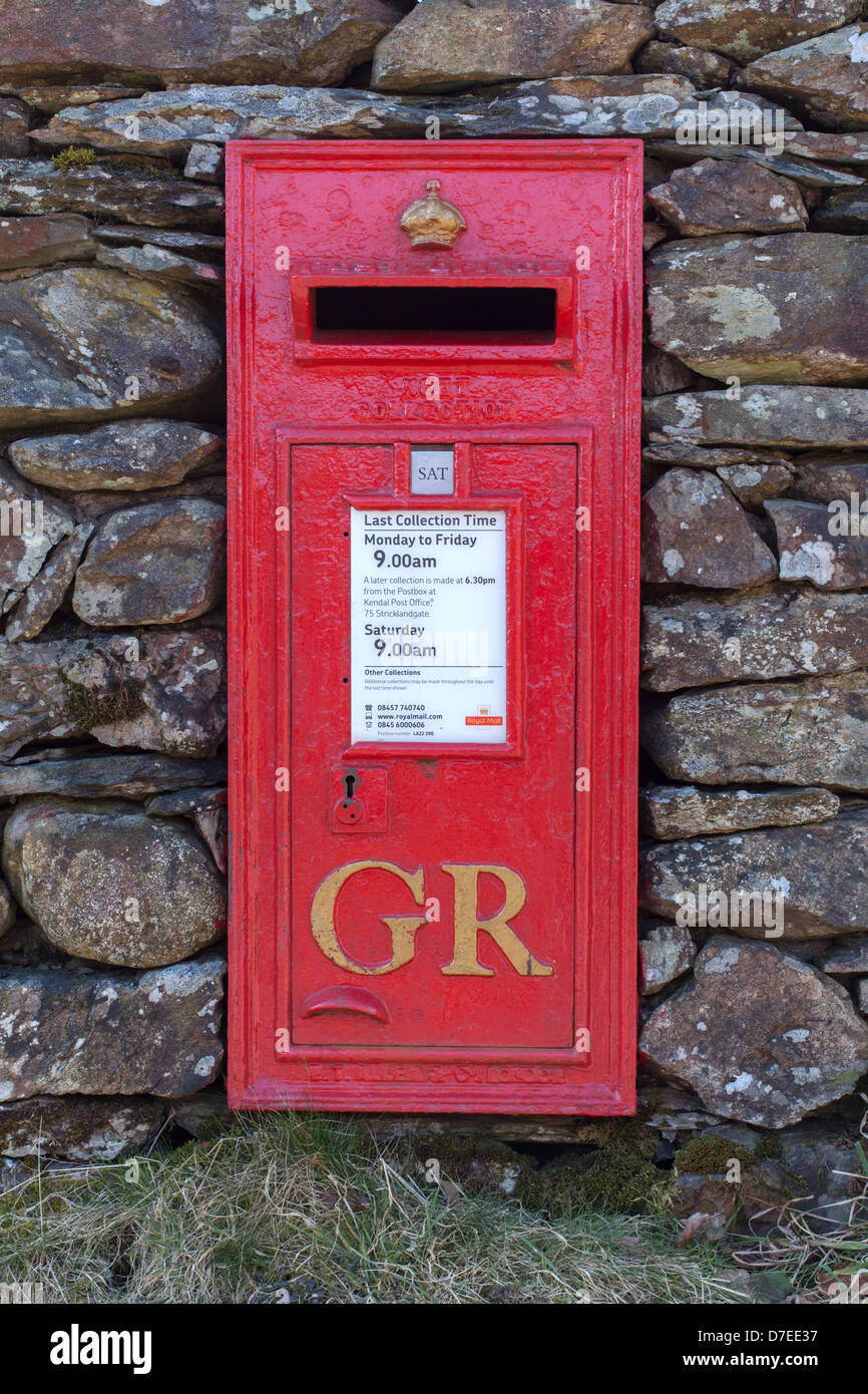Red Post Box in dry stone wall, Loughrigg, English lake District, UK - Stock Image