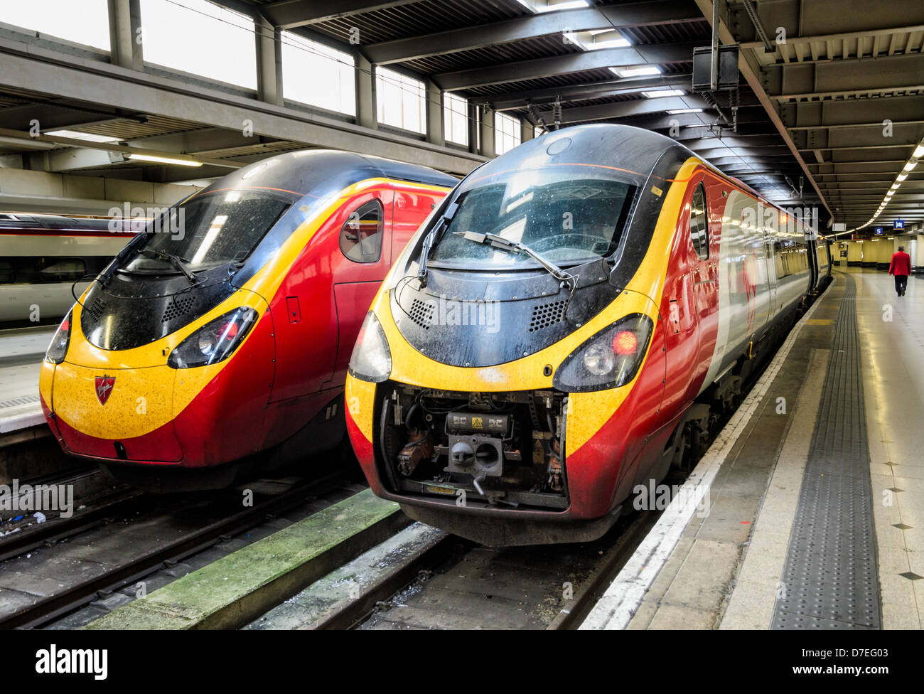 Pendolino trains operated by Virgin Trains wait at Euston Station, London, England. One appears to be undergoing - Stock Image