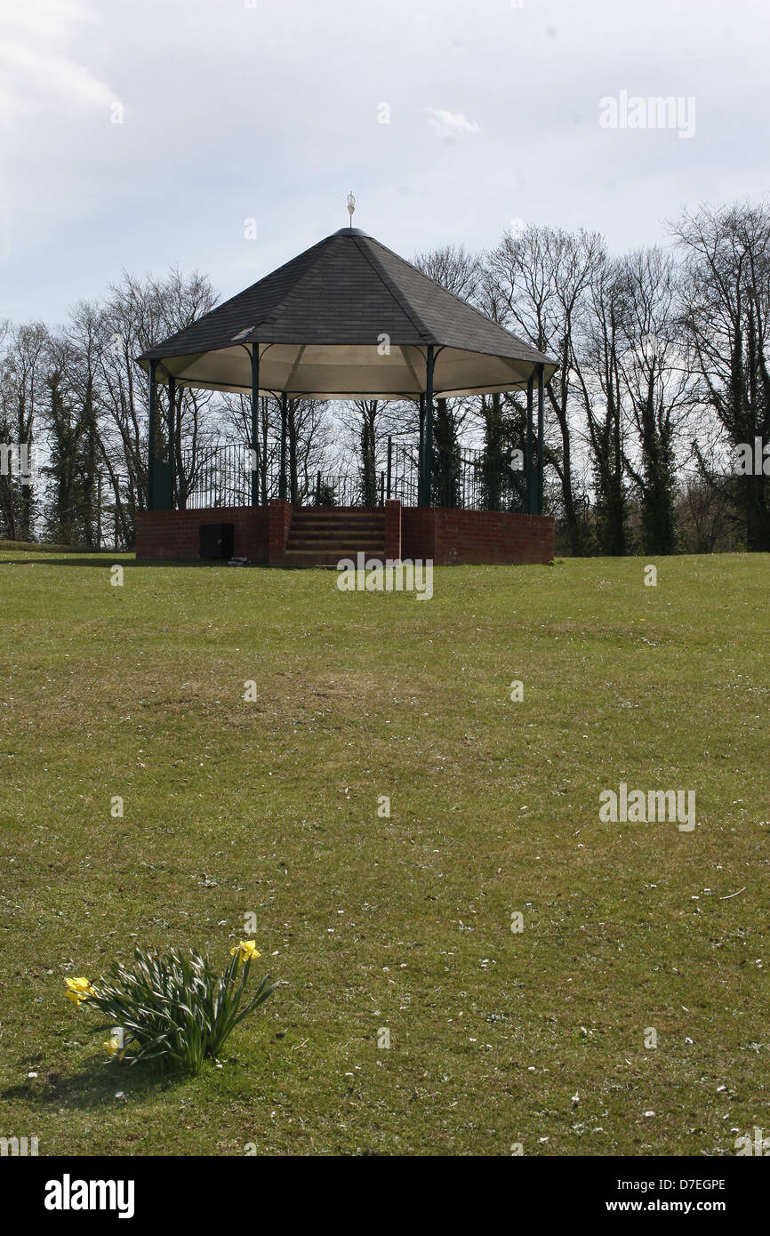 bandstand with daffodils in foreground. Langold Lake, Langold, Notts, England, UK - Stock Image