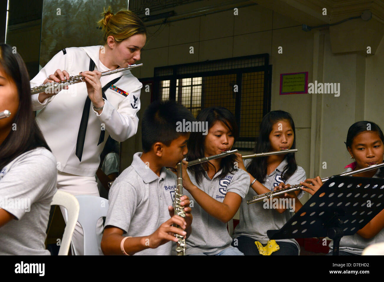 U.S. 7th Fleet Band works with music students. Stock Photo