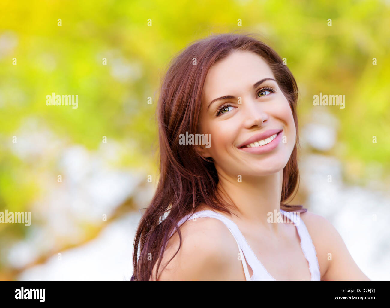 Closeup portrait of beautiful brunette woman in spring park, having fun outdoors, freedom and happiness concept - Stock Image