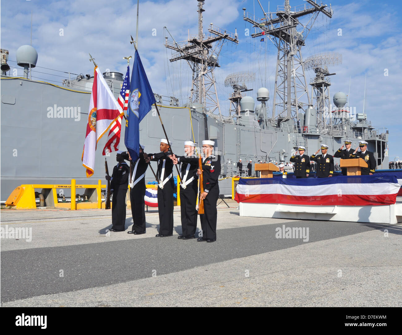Sailors present colors at the decommissioning of USS Klakring. - Stock Image