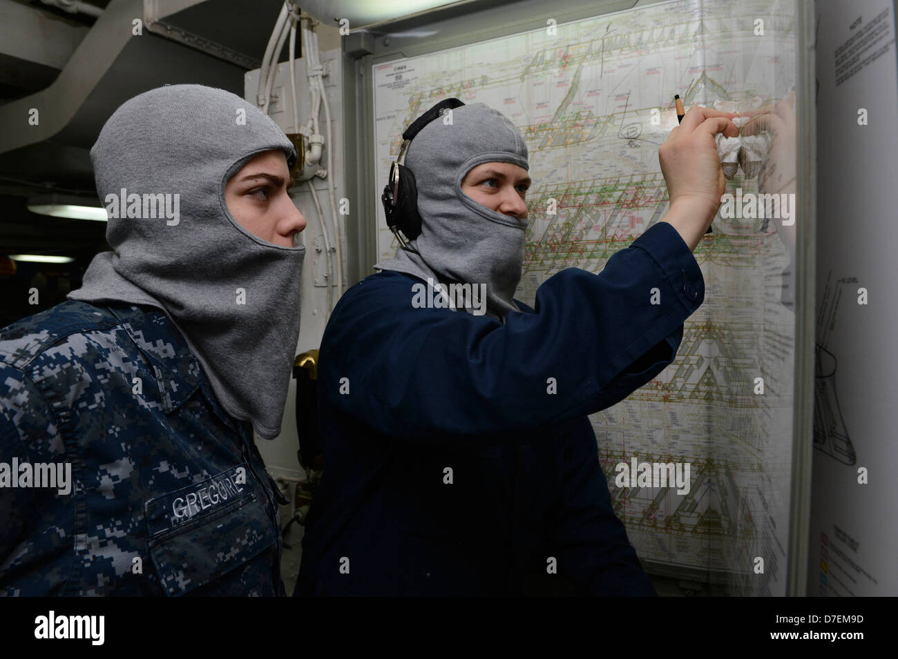 Sailors track casualties during a drill at sea. - Stock Image