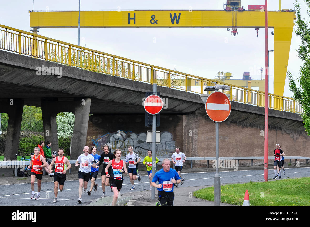 Belfast, Northern Ireland, UK. 6th May 2013. Runners pass the iconic Harland and Wolff cranes as they compete in - Stock Image