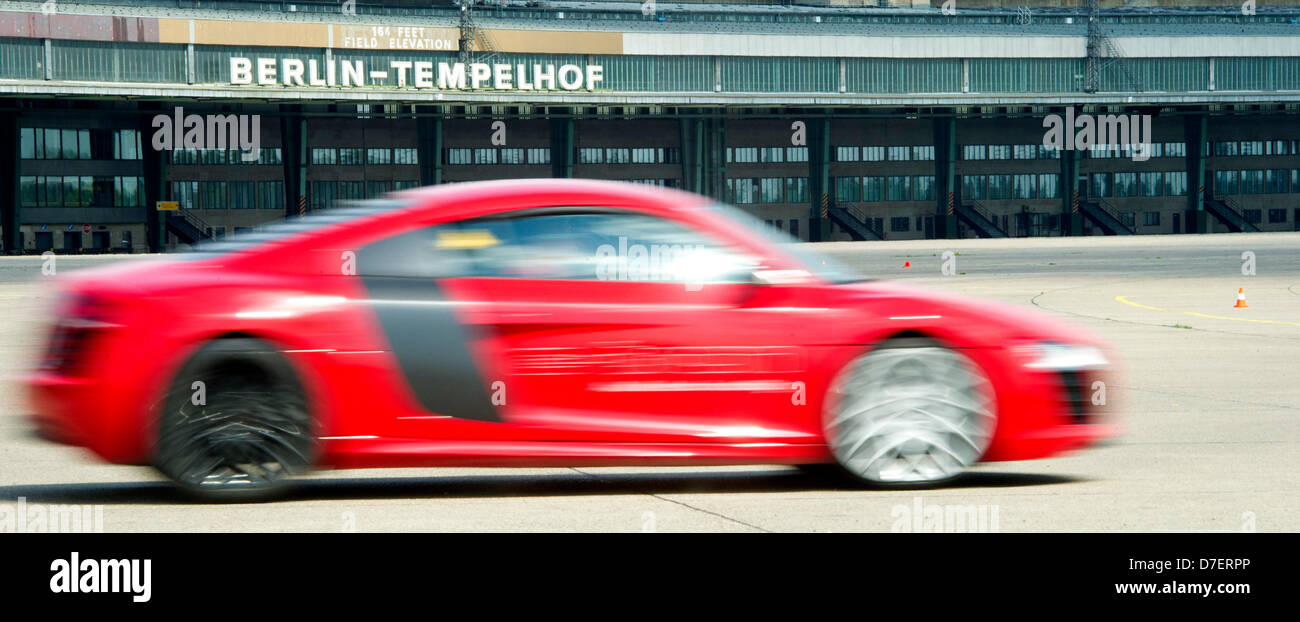 An Audi R8 e-tron drives around at Tempelhofer Feld in Berlin, Germany, 06 May 2013. Audi will be focusing on plugin - Stock Image