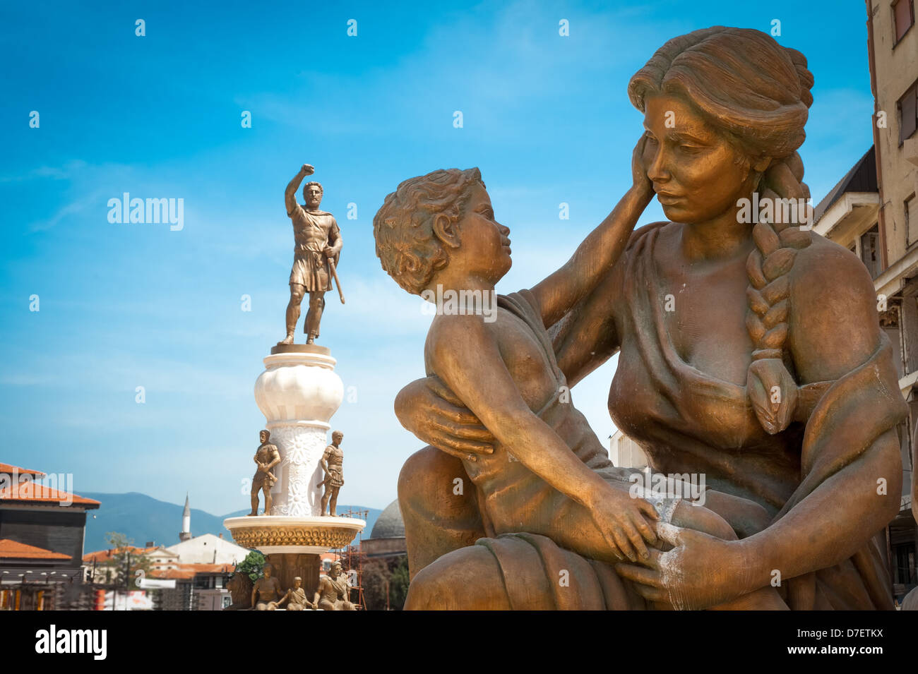 Statue of mother & son and statue of Alexander the Great in background, in center of Skopje (downtown), Macedonia - Stock Image