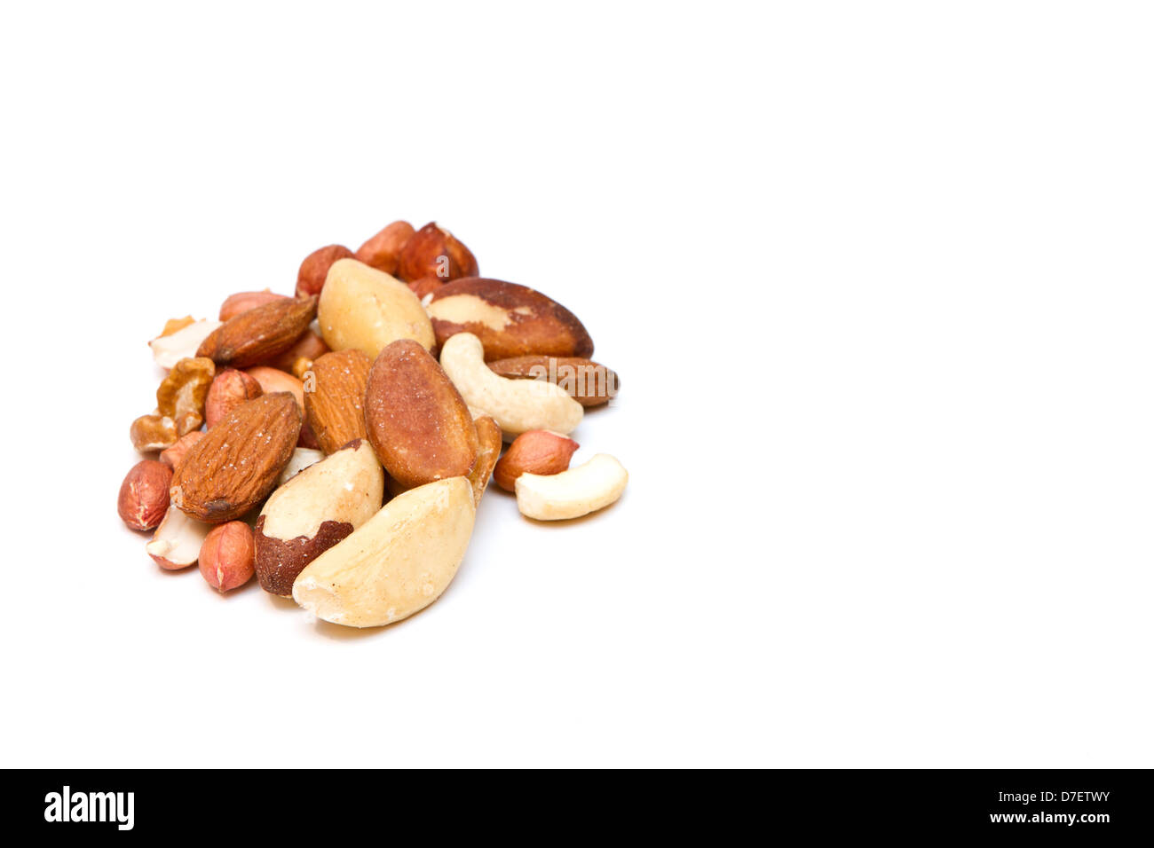 mixed nuts on white with copy space - Stock Image