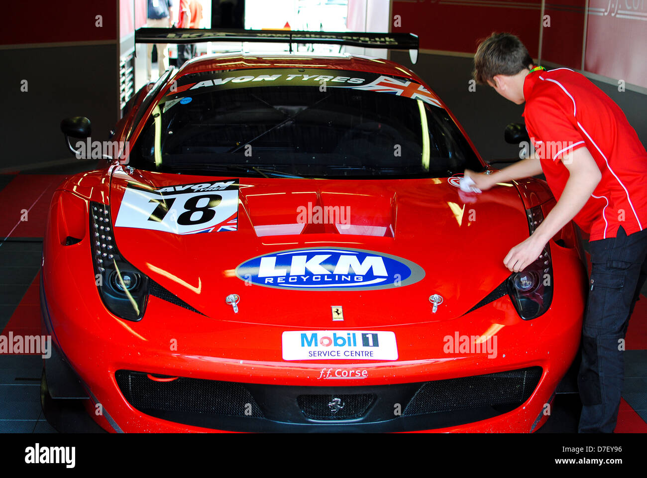 Ferrari race car being polished - Stock Image