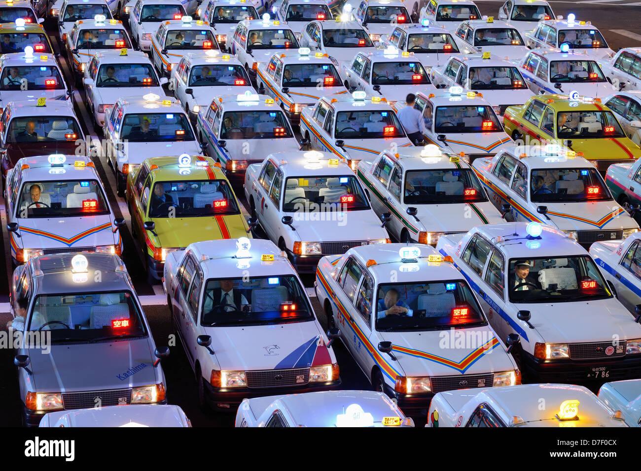 Taxis wait in Sendai, Japan - Stock Image