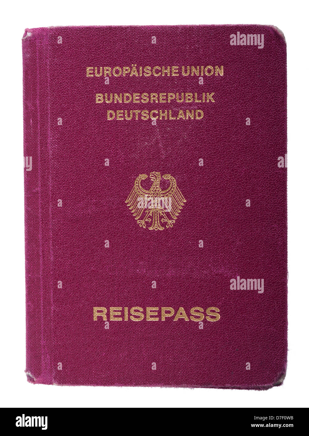 A worn out used German passport Isolated on white background. - Stock Image