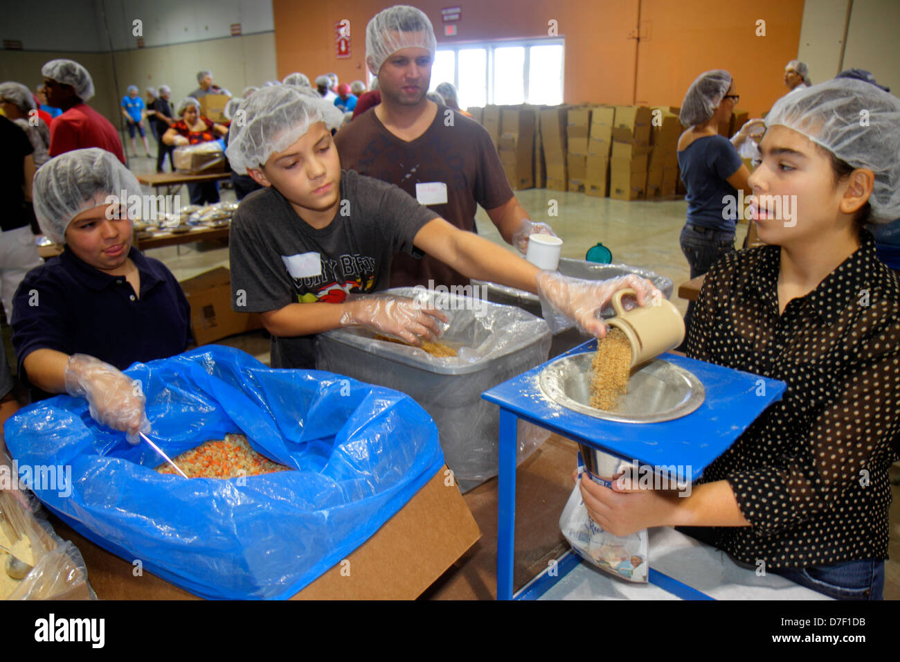 MiamiMiami Florida-Dade County Fair And Expo Feed My Starving Children volunteer community service packing meals - Stock Image
