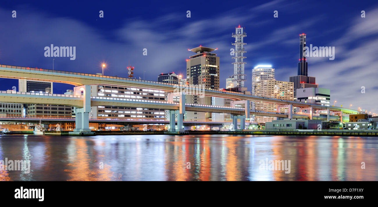 Modern cityscape with natural reflections in a puddle of Kobe, Japan. - Stock Image