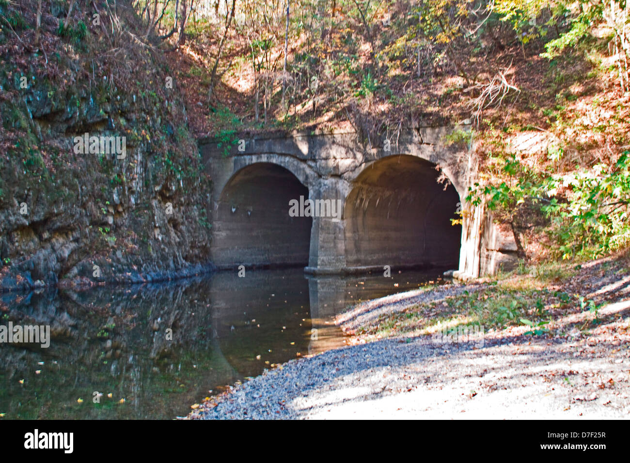 Fifteen Mile Creek flowing through duel stone culverts under an