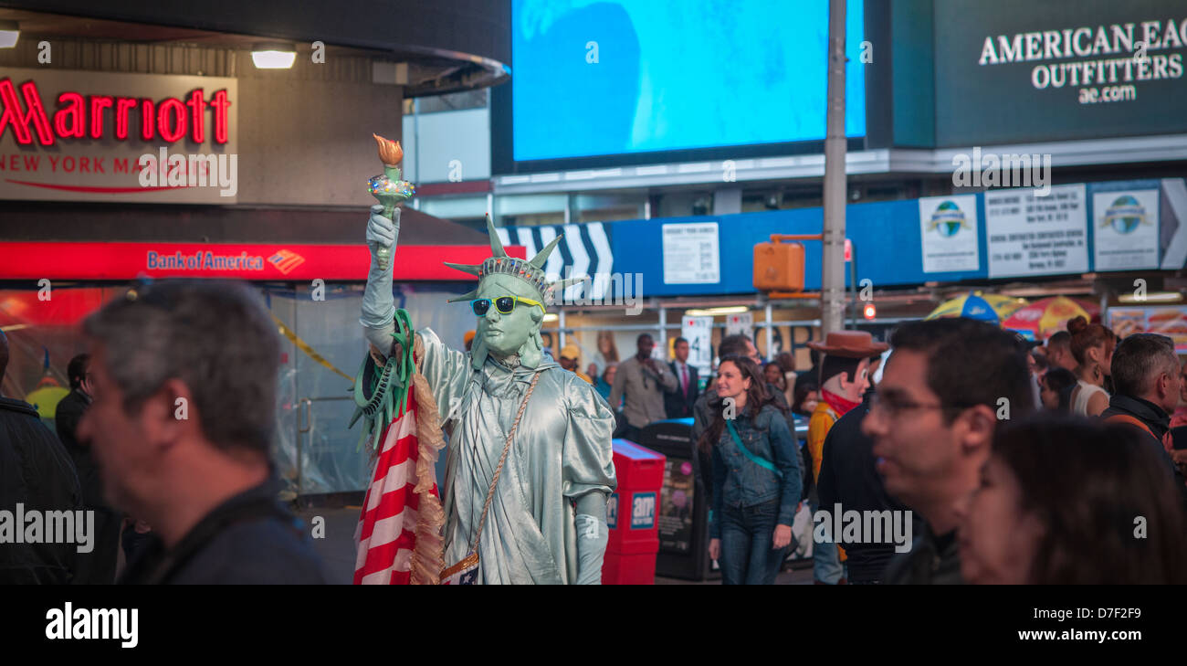 Costumed characters swarm Times Square in New York - Stock Image