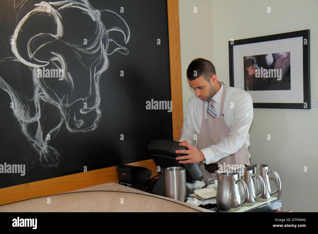 Miami Beach Florida Ocean Drive Betsy Ross Hotel BLT Steak restaurant Hispanic man waiter manager cash register Stock Photo