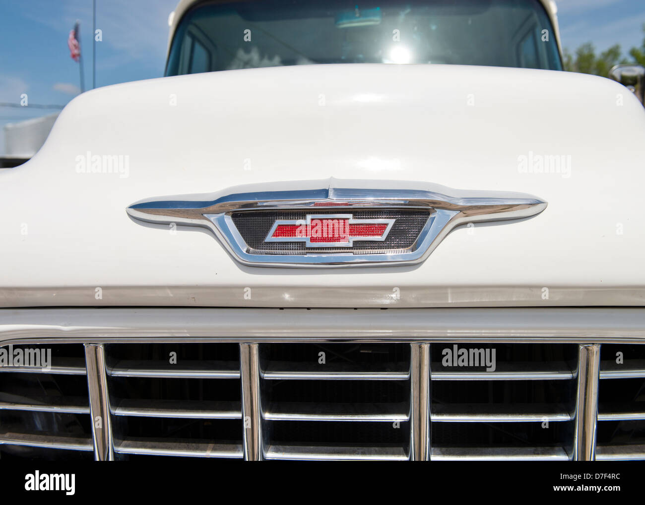 A white, classic 1955 Chevrolet V8 pickup front end closeup. American classic pickup, USA. - Stock Image