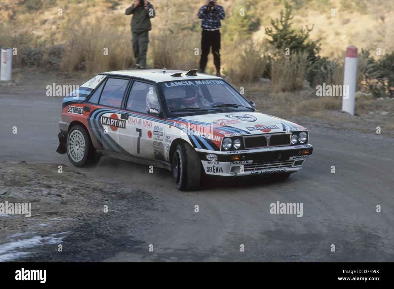 https://c8.alamy.com/comp/D7F59X/lancia-delta-integrale-on-the-monte-carlo-rally-1990-auriol-didier-D7F59X.jpg