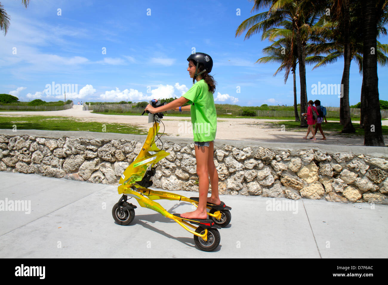 Miami Beach Florida Ocean Drive Lummus Park Tribred by Trikke electric vehicle rented rental girl riding safety - Stock Image