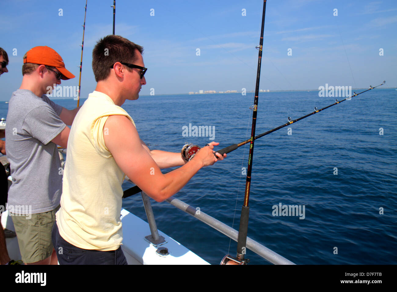 Miami Beach Florida Atlantic Ocean water charter fishing boat onboard man fair skin sunburn rods deep sea - Stock Image