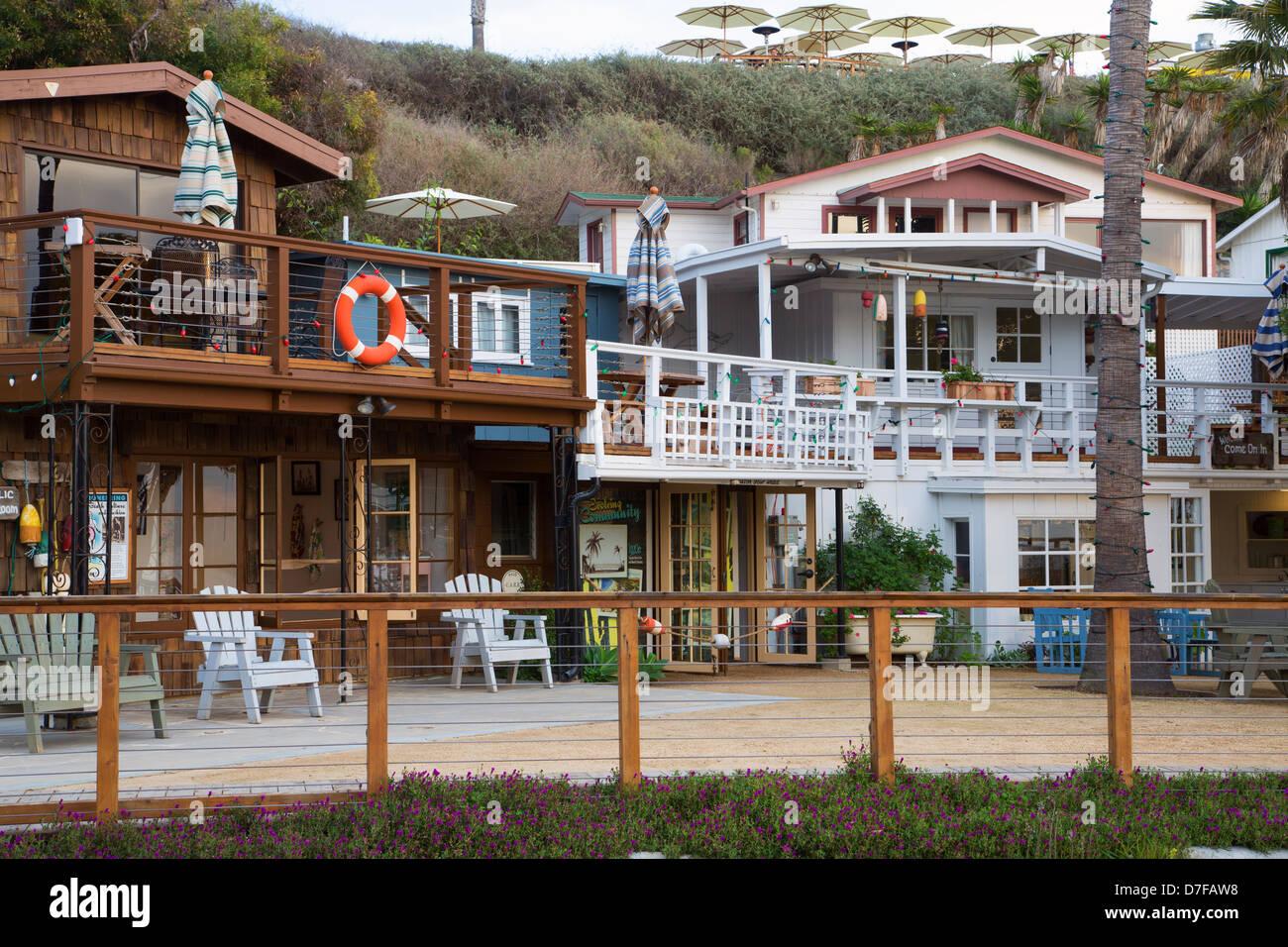 full village orange loop cottages of beach cottage al real in estate cypress property image
