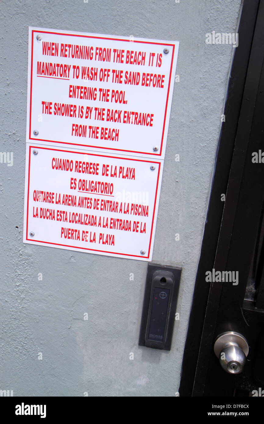 Miami Beach Florida door sign notice English and Spanish language mandatory returning from beach wash off sand before entering r & Miami Beach Florida door sign notice English and Spanish language ...