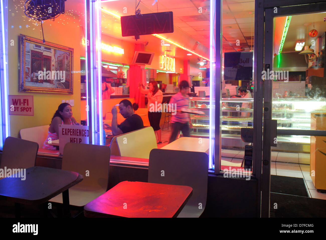 Miami Beach Florida Alton Road pizza parlor restaurant wi-fi hot spot night nightlife interior inside customers - Stock Image