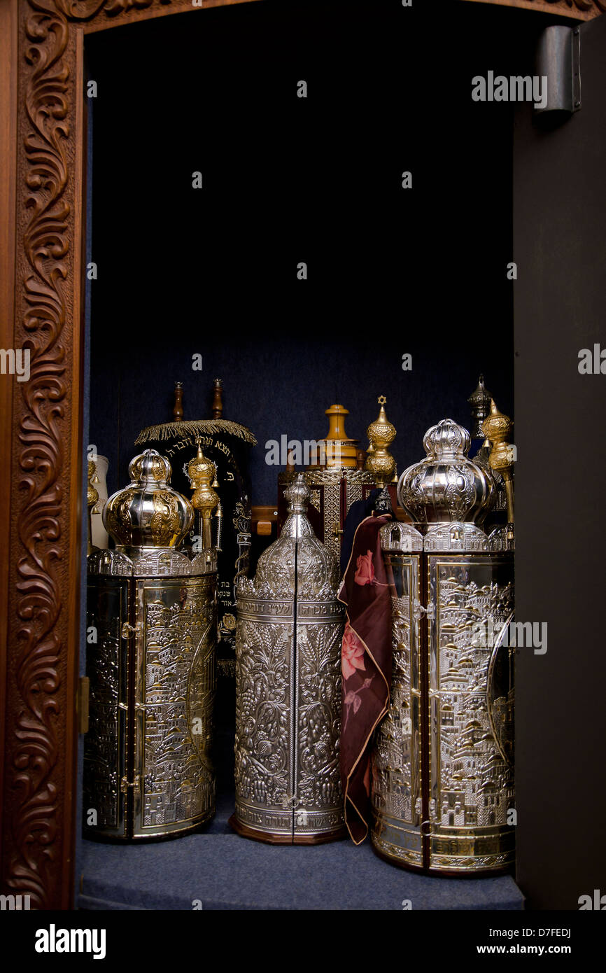 An Open Cabinet With Several Torah (old Testament) Scrolls Closed In Gold  And Silver