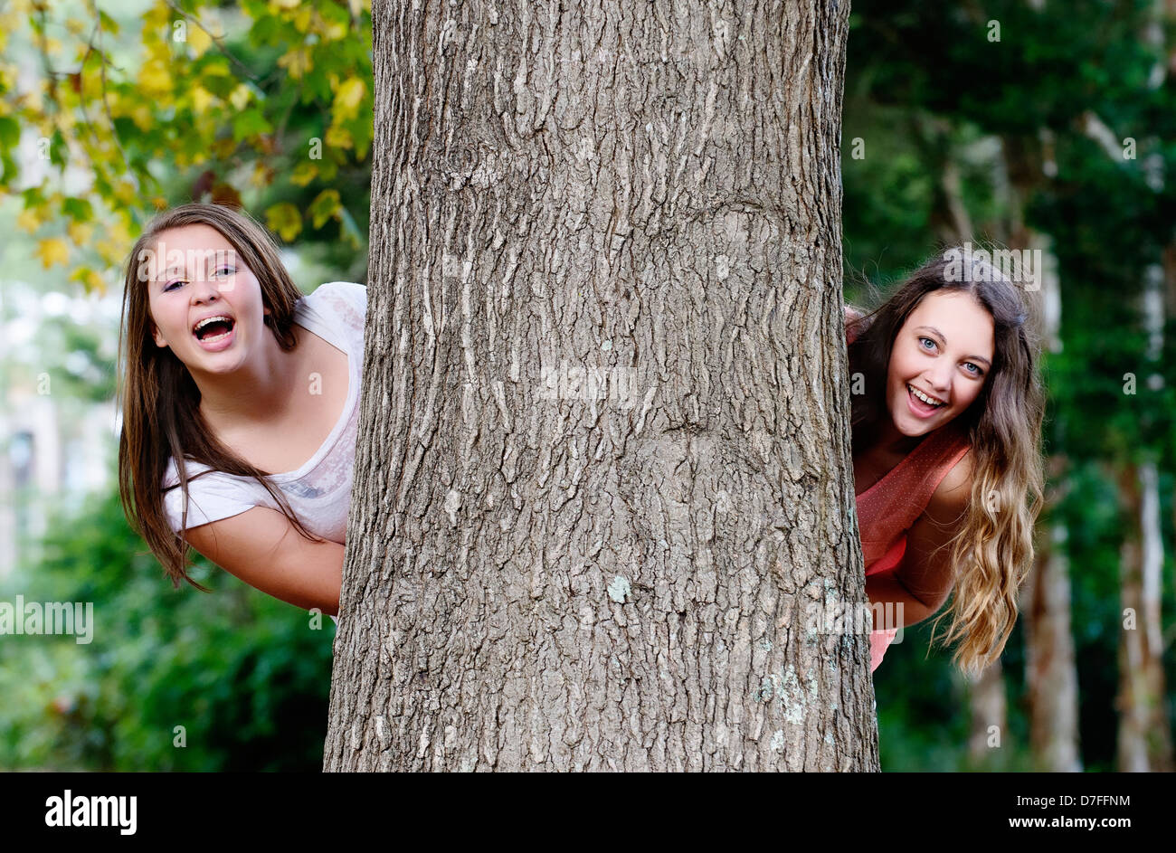 Two best friends playing in a park Stock Photo