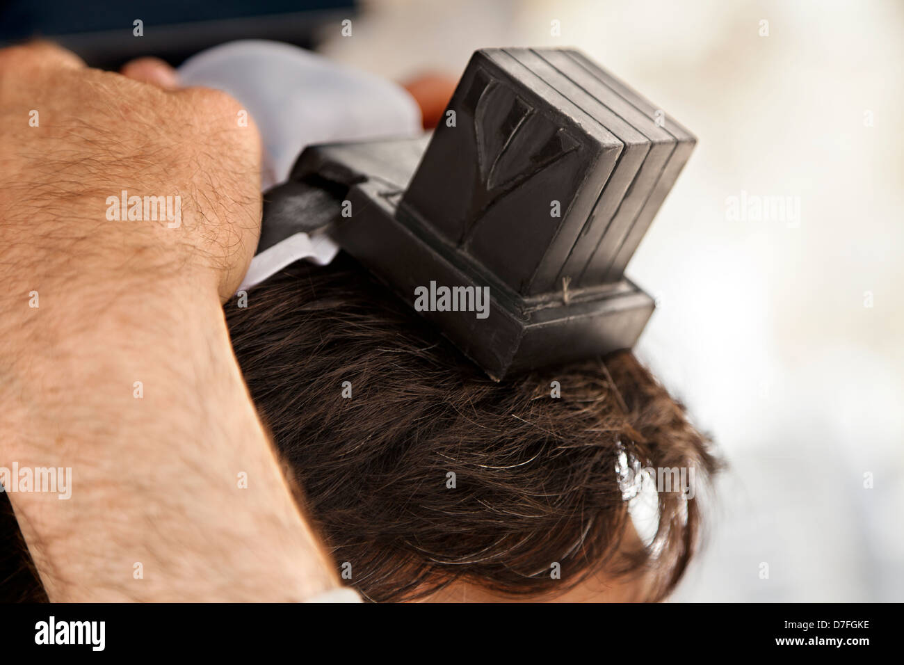 The head an adult Caucasian man is being wrapped in leather strap part Jewish phylacteries (Teffilin Tefilin Tfilin) - Stock Image