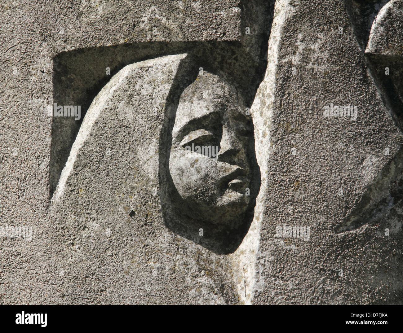 An orphan's face engraved on a section of Janusz Korczak Sculpture In Front Of The Krochmalna Street Orphanage - Stock Image