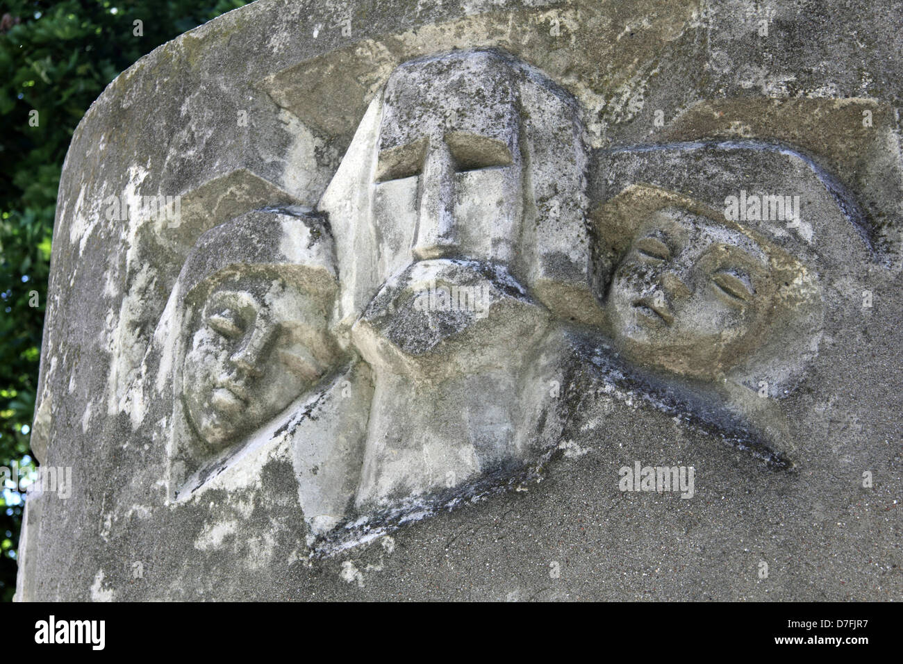 Janusz Korczak and Orphans' faces engraved on a section of a Sculpture In Front Of The Orphanage In Warsaw, - Stock Image