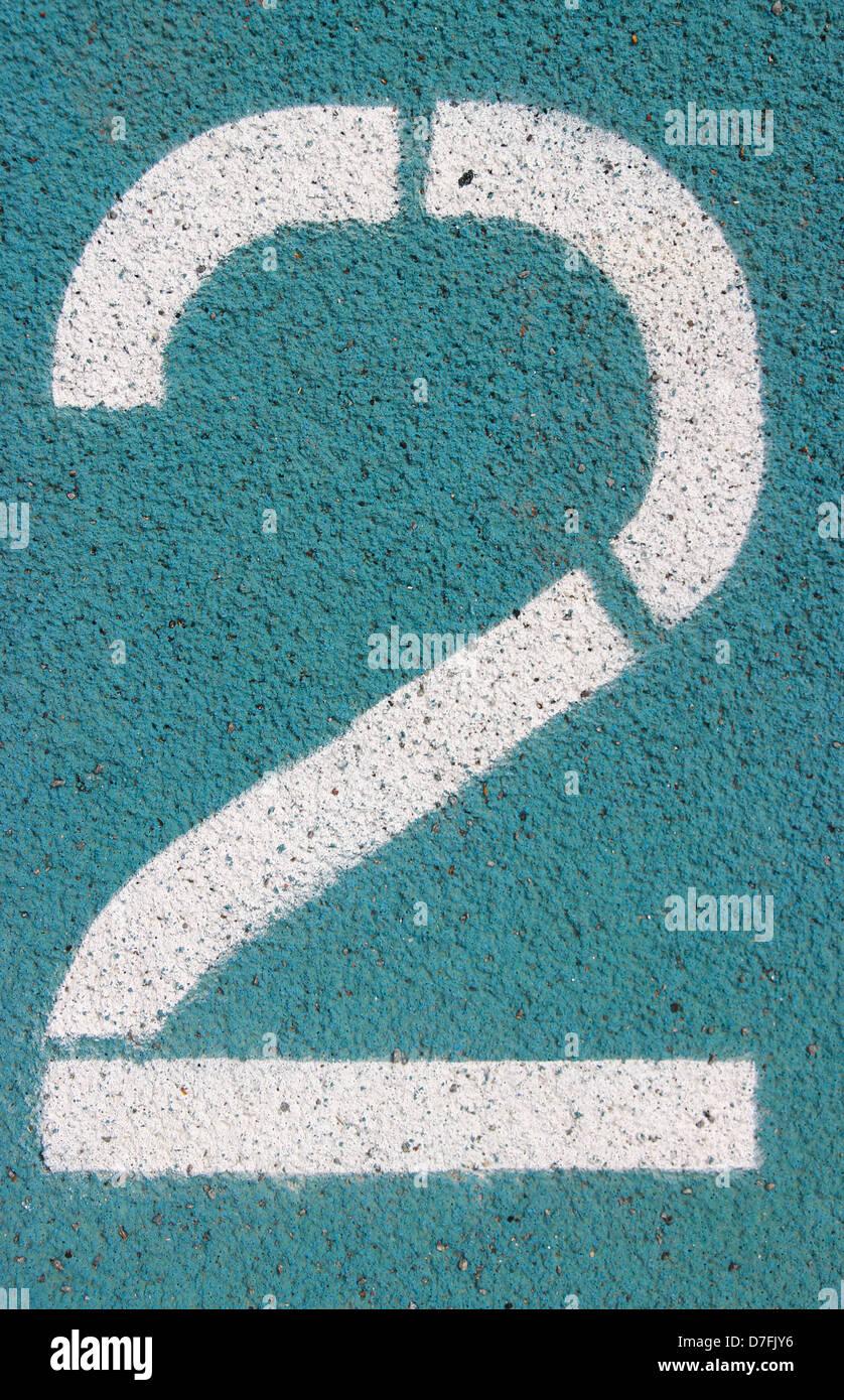 digit 2 on a blue athletics track - Stock Image