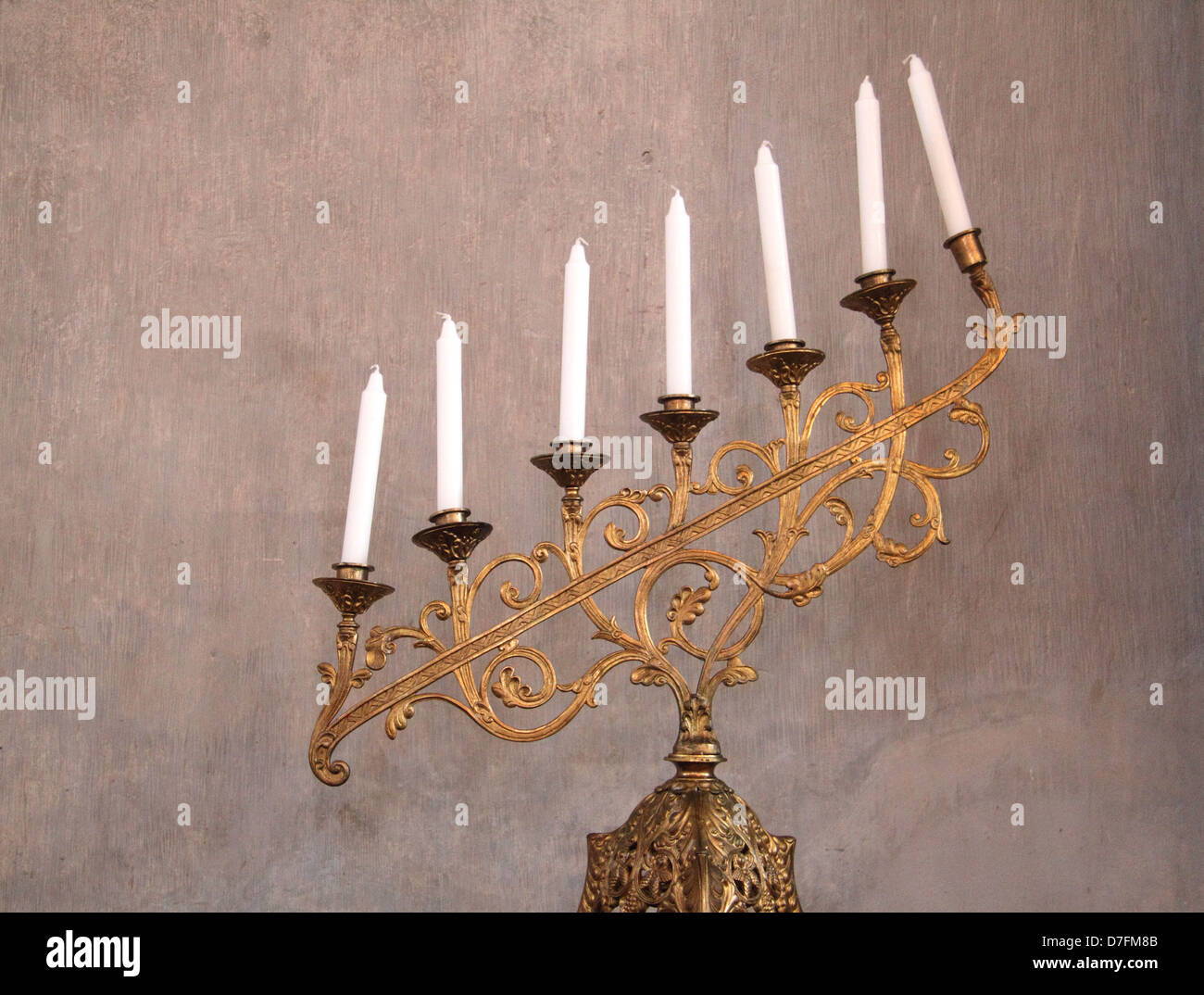 A golden seven-branched Menorah located by The Holy Ark At Tykocin (Tiktin) Synagogue, Poland - Stock Image