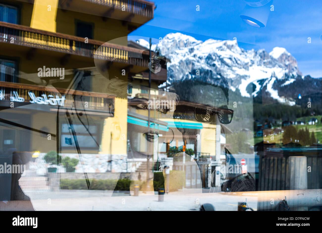 Italy Dolomites Veneto Cortina D'Ampezzo reflections of luxury stores shopwindow - Stock Image