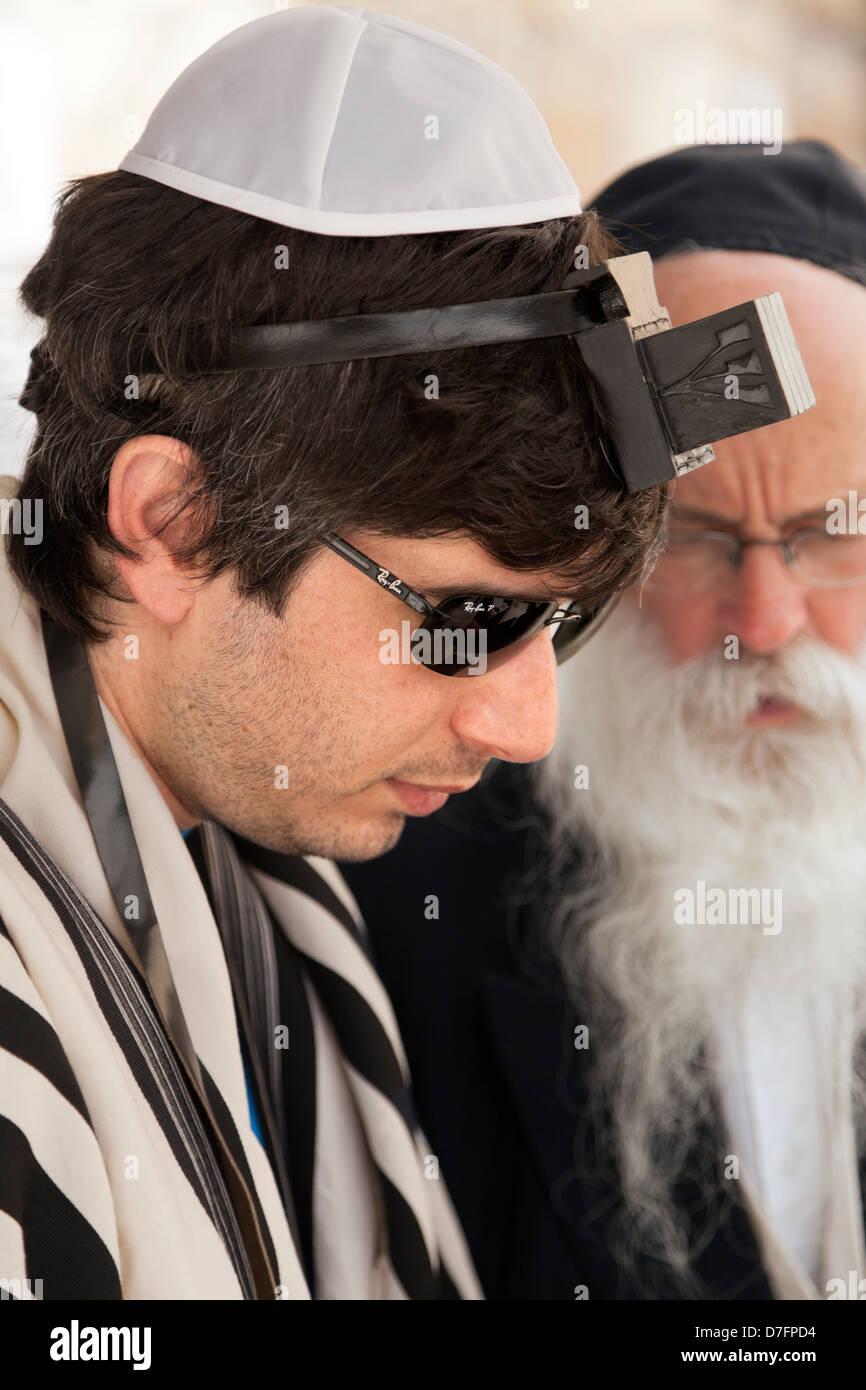 Jerusalem Israel - May 9th 2012: An adult Caucasian man wearing praying shawl Yarmulke Phylacteries while being - Stock Image