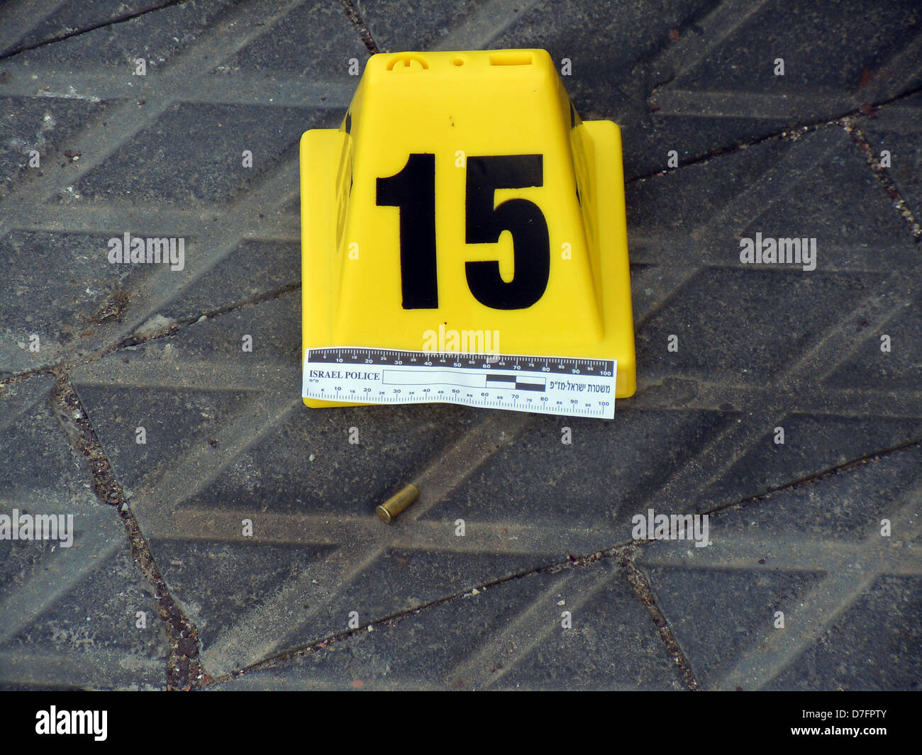 Police evidence marker next to a cartridge (Shell of a bullet) at a crime scene in Jaffa (Tel Aviv) on Feb. 24th - Stock Image