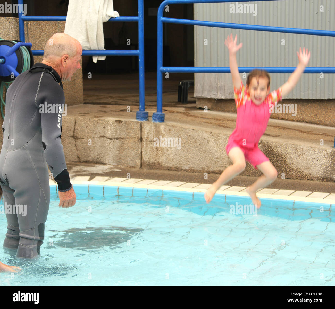 Child jumps into water during Hydrotherapy (hydropathy) treatment Stock Photo